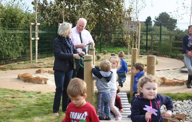 Cllr Andy Skeats and Cllr Mrs Barbara Manuel cutting the ribbon to officially open the nature garden at Hopscotch pre school
