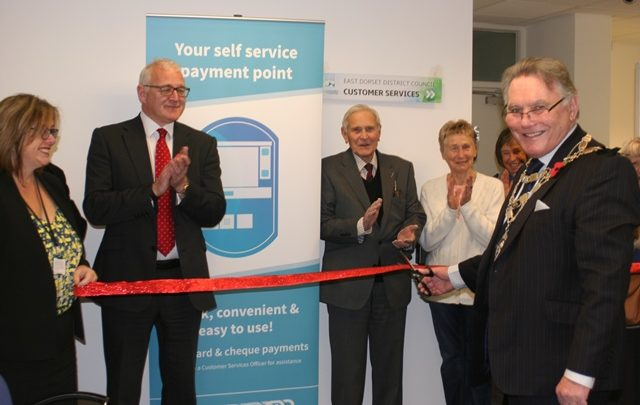 The Chairman of East Dorset District Council cutting the ribbon to declare the new office open