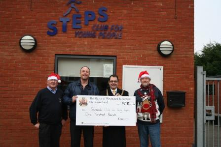 Mayor of Weymouth and Portland and President of Weymouth & Portland Lions club presenting Steps with cheque.