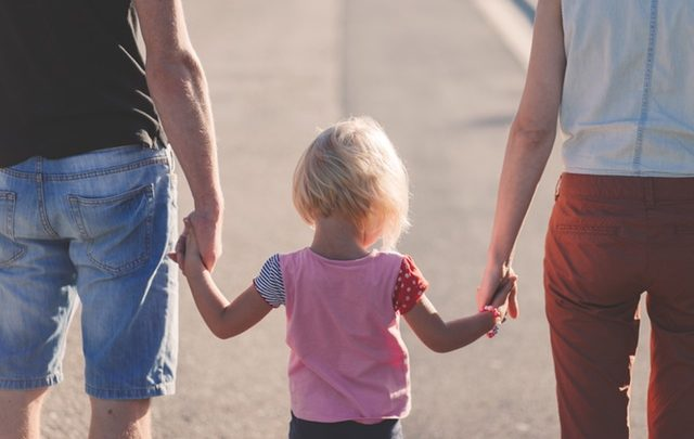 pexels-photo-173666_family holding hands