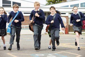 happy children are running across a playground.