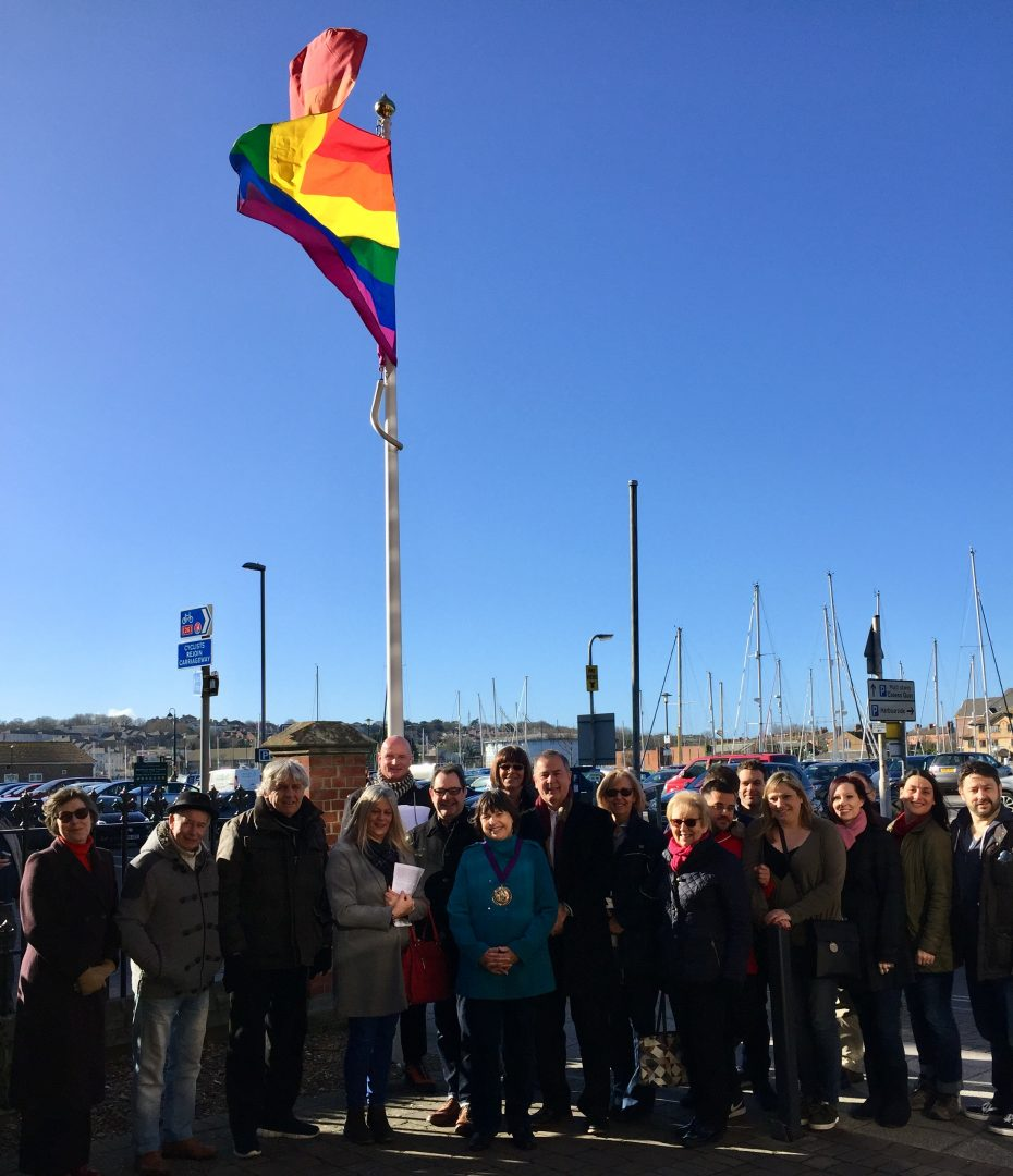 Photo of people with the rainbow flag at the council's Commercial Road offices